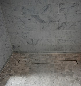 LUXE_Linear_Drain_Nice_Closeup_or_Gray_Tile_Shower_300_Media